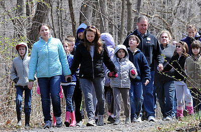 """Lorain County home school students learn about the Underground Railroad on """"Road To Freedom"""" program at French Creek Reservation on April 13.  Students walked through the park as runaway slaves on the journey to freedom with the help of reenactor portrayals. STEVE MANHEIM/CHRONICLE"""
