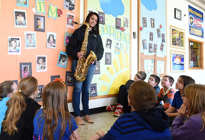 KRISTIN BAUER   CHRONICLE North Ridgeville High School senior Kaylani Othman, 18, explains the different types of musical instuments to a group of Wilcox fifth graders, including her personal tenor saxophone which she plays in the high school band.  Othman one day hopes to be a teacher, and has placed second in the Educators Rising State Competition for Lesson Planning in the category of Arts for teaching a lesson about music dynamics to 5th graders at Wilcox Elementary.  In June, Othman advances to the Educators Rising National Conference competition, held in Boston.