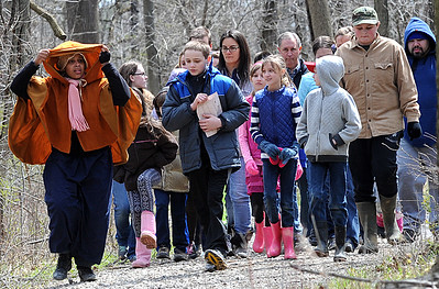 """Lorain County home school students learn about the Underground Railroad on """"Road To Freedom"""" program at French Creek Reservation on April 13.  Students and parents walked through the park as runaway slaves on the journey to freedom with the help of reenactor portrayals  STEVE MANHEIM/CHRONICLE"""