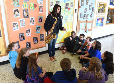 KRISTIN BAUER | CHRONICLE North Ridgeville High School senior Kaylani Othman, 18, explains the different types of musical instuments to a group of Wilcox fifth graders, including her personal tenor saxophone which she plays in the high school band.  Othman one day hopes to be a teacher, and has placed second in the Educators Rising State Competition for Lesson Planning in the category of Arts for teaching a lesson about music dynamics to 5th graders at Wilcox Elementary.  In June, Othman advances to the Educators Rising National Conference competition, held in Boston.