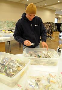 "Kris Carlson of Wakeman sorts through fishing lures at ""Holy Mackerel Fishing Tackle Flea Market"" at New Russia Township Hall, 46300 Butternut Ridge Rd, Oberlin, on Thursday, April 7. STEVE MANHEIM/CHRONICLE"