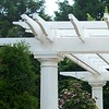 Decorative ends on a PVC Trellis wtih Round Fiberglass Columns