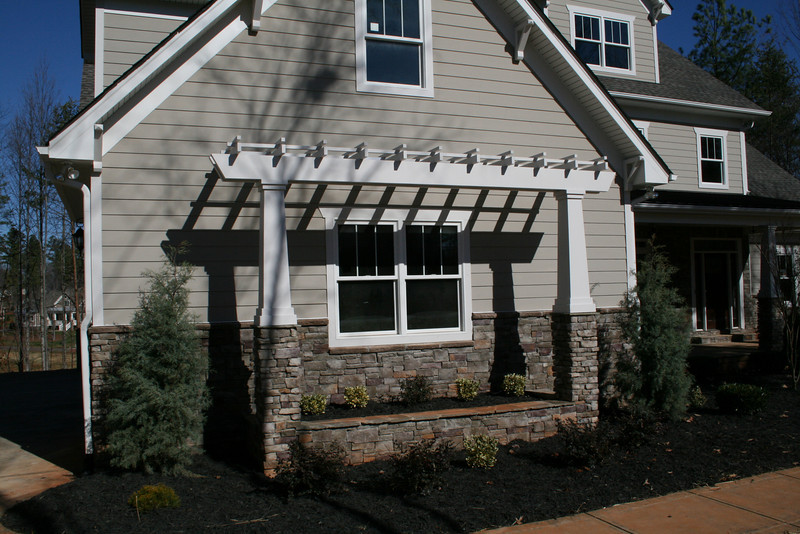 PVC Trellis and Tapered Square Columns add charm to this elevation