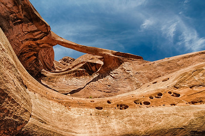 Ring Arch in  Arches National Park is off the beaten path and across a river.