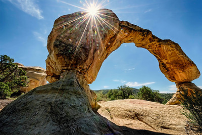 in New Mexico, Cox Canyon arch in the late morning of summer.  The sun bursts over the edge.