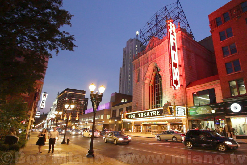 """Grand Center"" is the long-time theatre district of St. Louis and home to the Fabulous Fox Theatre.  Originally opened in 1929 by movie mogul William Fox, the magnificent movie palace fell into disrepair in the 1970's until it received a magnificent restoration by Leon and Mary Strauss and the Fox Associates in 1982.  Today the theatre presents big-name concerts and the best of Broadway musicals.  The Fabulous Fox continues to see upgrades and restorations; here the recently replaced marque and ""blade sign"" light-up the night life on Grand Avenue."