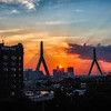 "The Secret Service Approach<br /> Well I didn't shoot the Zakim Bridge as much as I would have liked. I had so many spots I wanted to get it was hard to hit them all at the right time. There is one spot I really wanted to get but it might have to wait until I can pay my way to it! <br /> <br /> So we wandered around the area for a bit trying to get the perfect spot. For a while I just wasn't happy with any angle that we came to. Finally we saw this parking garage and had to get to the top of it. So we walk in, went up the stairs to the top deck and found this pretty awesome view. It had a ledge, so I just spread the tripod legs and put it over the ledge and it held up nicely. I started taking some bracketed shots and then did a timelapse for the rest of it. <br /> <br /> Down on the street we noticed this couple which were on a run and all geared up for it. The kept looking up at us though, like something was up. My tripod did look a bit odd the way I had it clawed around the ledge. But it's just a camera with some filters on it. It looked like the women runner was trying to get into the building or something. I figured she had to go pee. But she comes back out and they continue to stand around glancing up at me. Then a women who worked in building walks out leaving work, but always gives us that weird look. As I am continuing my timelapse, I turn around and see this giant secret service looking guy walking at us. I thought to myself, ""this guy definitely doesn't work for the parking garage!"" He was all decked out, ear piece and suit. Then he asks me if we are with the press, and I reply that I am just shooting the sunset. Simply said, he says thats all he needs to know and leaves. I have more trouble at public buildings, and this was Secret Service, hummm. <br /> <br /> That is when were started questions about what building is across from us. So my buddy googled the address and found out it was Mitt Romney's Sponsorship Headquarters, haha, that explains it all. And I am pretty sure the runners where undercover and just circle near by all day. Who knows! <br /> <br /> Well that is my little story behind this shot. Hope you enjoy. <br /> <br /> This is one shot<br /> Canon 5D MK III<br /> Canon 17-40mm f/4 L<br /> Induro CT214 Tripod<br /> ISO 50 <br /> f/22<br /> 1/20 Second<br /> LEE .9 ND Soft Graduated Filter<br /> More: <a href=""http://smu.gs/PcDUUV"">http://smu.gs/PcDUUV</a>"
