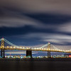 I Can't Get Enough of This City - Bay Bridge<br /> <br /> Another one from the other night at the Treasure Island Photowalk.<br /> <br /> Canon 5D MK III<br /> Canon 7-200mm f/4 L<br /> ISO 100<br /> f/18<br /> 206 Seconds