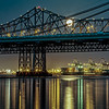 Black Gold - Super Moon Had to post another Super Moon shot from May. This one the moon is just passing through the Bay Bridge and reflecting nicely in the Bay!   Canon 7D Canon 70-200mm f/4 L ISO 100 f/16 30 Seconds  Buy this shot here: http://tobyharriman.smugmug.com/Photography/San-Francisco/23998223_S39VQZ#!i=1965441305&k=dZSZsfD
