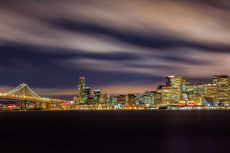 """Purple Fluff - San Francisco Skyline  Here is one of my favorite ones from the other night.  Canon 5D MK III Canon 70-200mm f/4 L ISO 100 f/18 260 Seconds  GPS: 37.819786,-122.374357  Prints: <a href=""""http://tobyharriman.smugmug.com/Photography/San-Francisco/23998223_S39VQZ#!i=1977491996&k=t93PpD6"""">tobyharriman.smugmug.com/Photography/San-Francisco/239982...</a>  [<a href=""""http://www.tobyharriman.com"""">www.tobyharriman.com</a>] [<a href=""""http://www.facebook.com/pages/Toby-Harriman/106594969435682"""">facebook</a>] [<a href=""""http://www.plus.google.com/102691005290181713701"""">Google+</a>] [<a href=""""http://www.tobyharrimanphotography.tumblr.com"""">Tumblr</a>] [<a href=""""https://twitter.com/#!/tobyharriman"""">Twitter</a>] [<a href=""""http://www.redbubble.com/people/tobyharriman"""">redbubble</a>]  <a href=""""http://www.flickr.com/photos/tobyharriman/7612188740/in/photostream/lightbox/"""">View on Black</a>  © Toby Harriman all images Creative Commons Noncommercial. Please contact me before use in any publication."""