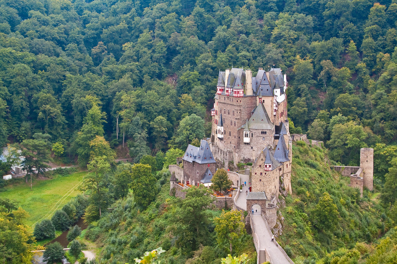 Burg Eltz, Munstermaifeld, Moselle River, Germany<br /> <br /> Burg Eltz is a medieval castle nestled in the hills above the Moselle River between Koblenz and Trier, Germany. It is still owned by a branch of the same family that lived there in the 12th century, 33 generations ago.<br /> <br /> The Rübenach and Rodendorf families' homes in the castle are open to the public, while the Kempenich branch of the family uses the other third of the castle.