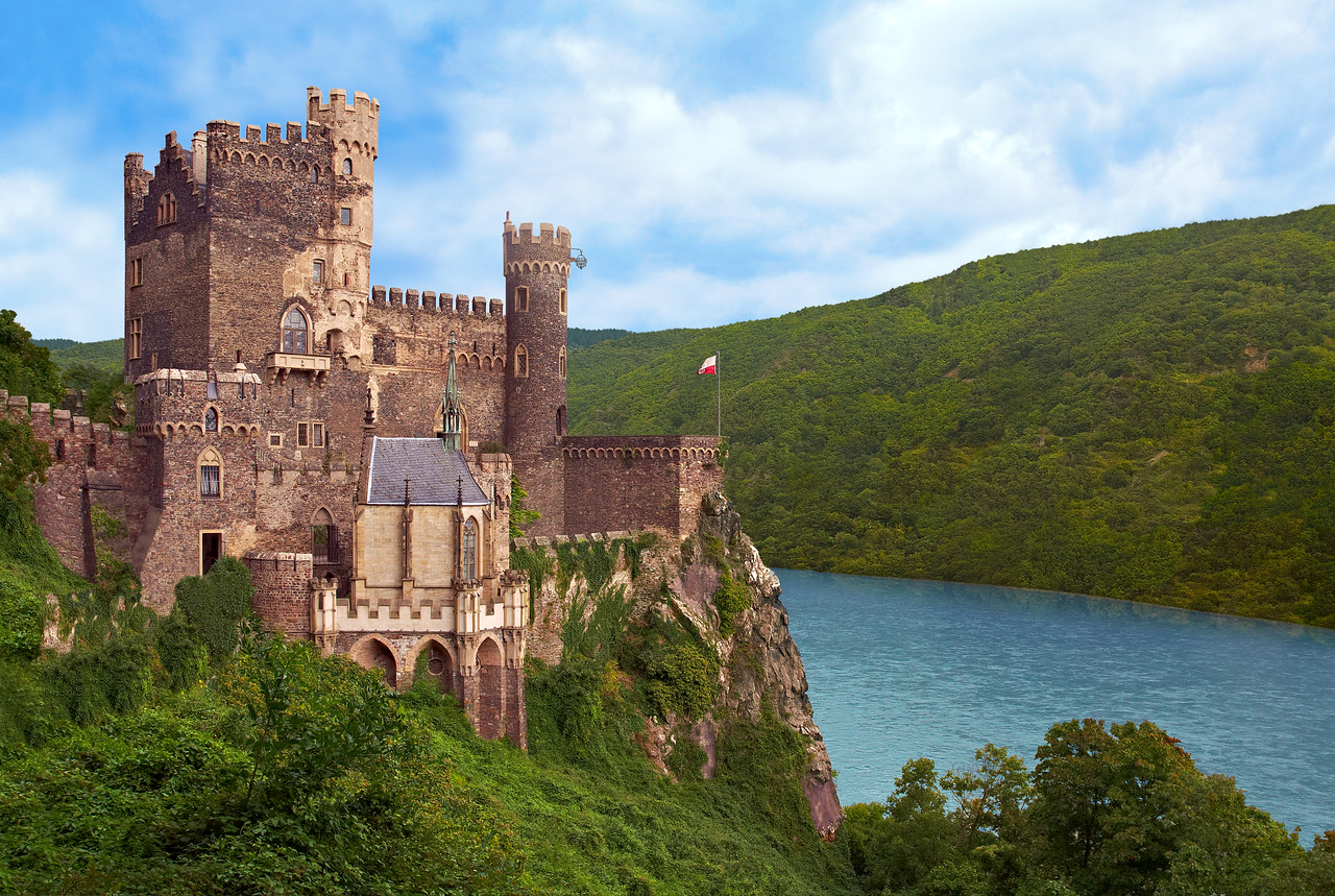 Burg Rheinstein, Trechtingshausen, Rhein River, Germany<br /> <br /> Particularly characteristic of the Rheinland castles is the position on a cliff, 260 ft. above the river. First mentioned in 1279, the castle became the property of the influential archbishop of Trier, Kuno von Falkenstein, in the 14th century. At the begining of the 19th century Prince Friedrich of Prussia acquired the ruins and had them rebuilt in psudo-Gothic style. Rheinstein contains a collection of armour and art treasures of the 16th & 17th century, which is well worth seeing.
