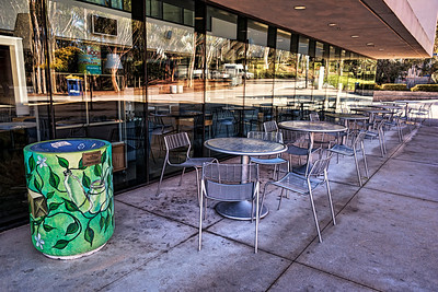 Over Christmas break on the campus of California State University at San Diego, the empty tables leave room for reflections in the windows.