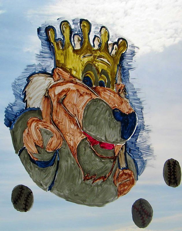 A painting of Slugger, the Kansas City Royals mascot, on the window of a grocery store.