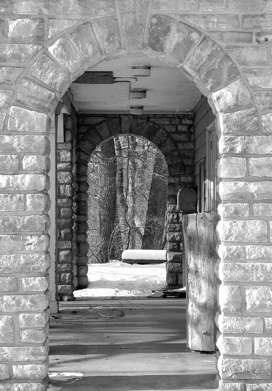 Stone archways on a building in Swope Park.