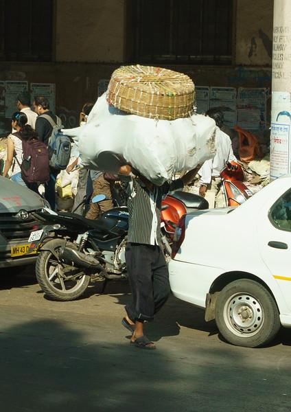 Hauling goods in Mumbai, India.