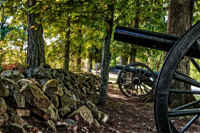 At Gettysburg, many cannon are arrayed along the one-time fighting lines.