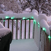 Christmas lights on the deck railing.