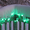 Christmas lights on the deck railing.  They're LED, so they won't melt the snow.