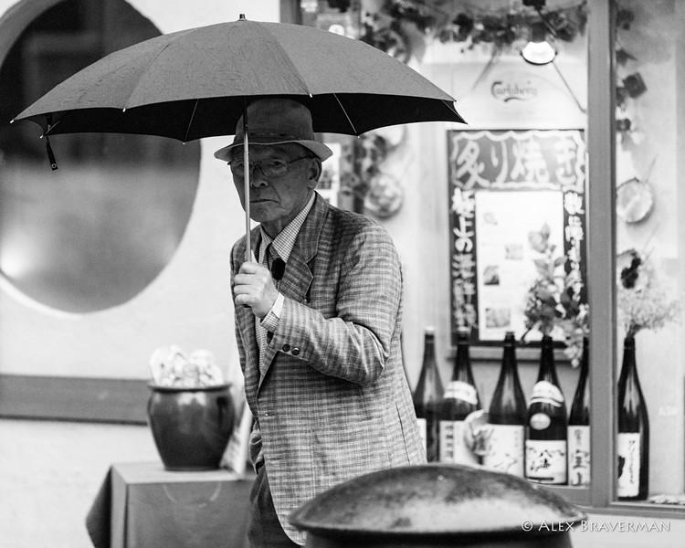 an old man with an umbrella