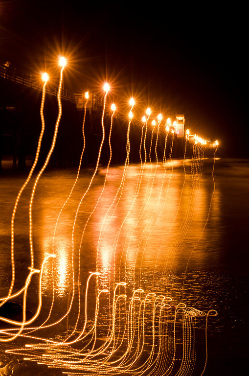 A long exposure fail. This is what happens when at 15 seconds through a 20 second exposure a wave comes up high and you need to grab the tripod and run.