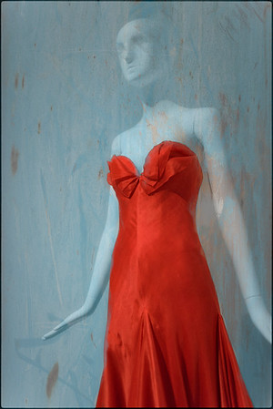 A red  Yves St. Laurent dress on display at the Artis-Naples Baker Museum, Naples, Florida.