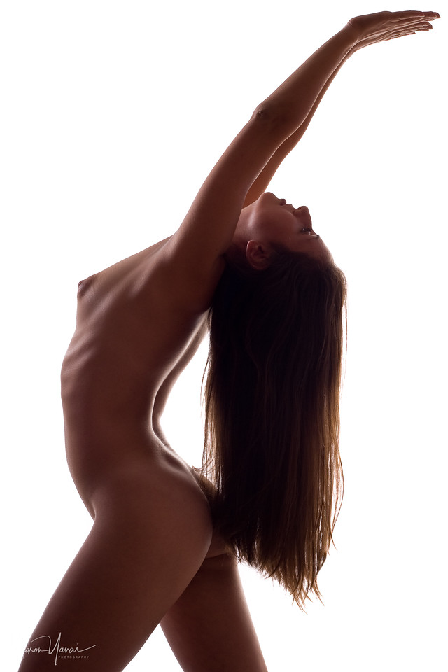 Naked woman stretching