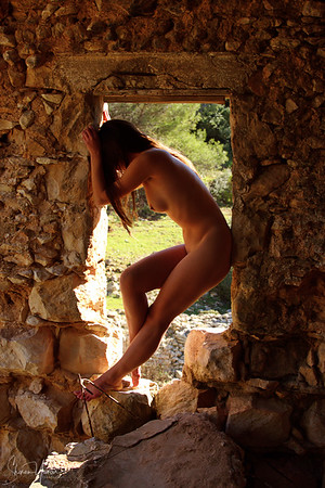 Naked woman at the window of an old castel
