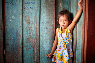 Cute shy girl in her home in Cambodia