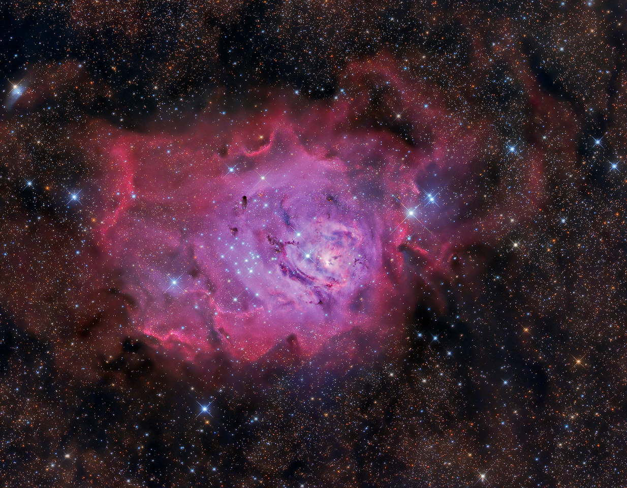 M8 The Lagoon Nebula is about 5000 light years from Earth and is about 110 light years across. This can be seen with naked eye from dark locations.  Taken Sept 1,2 2012 from New Mexico Skies FLI Microline 11002OSC ASA N10 Newtonian Astrograph 9X10min Darks, Flats, Bias