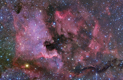 North American and Pelican Nebula's. This has about an hour of integration time. Shot this with a near full moon up so it came out pretty well. Shot with the Takahashi FSQ106 with reducer and the modded 5Dmkii. Autoguided on a CGEM with a Borg 60 and SBIG SG-4.  Captured with Backyard EOS Stacked in DeepSkyStacker Processing with PhotoShop CS5, Neat Image