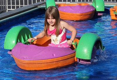 Lexxis Kramer of Grafton, 5, enjoys the paddle boat at the Queen of Peace Festival in Grafton. RAY RIEDEL/CHRONICLE