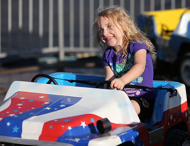 Layla Acord of Grafton, 4, drives a mini-jeep at the Queen of Peace Festival in Grafton. RAY RIEDEL/CHRONICLE