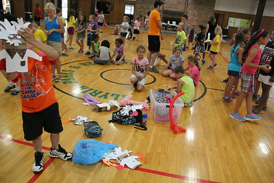 Children of all ages had the opportunity to create their favorite characters using paper bags and other crafting items during Elyria Park's Reach and Rise Discovery Camp at East Recreation Center on Aug. 6.   ALEC SMITH | CHRONICLE
