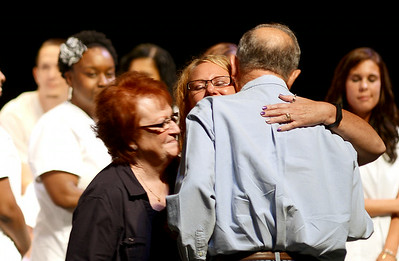 Katie Blue hugs her parents Penelope and Jim Blue, of Medina, after they gave her her nursing pin on Aug. 1.  KRISTIN BAUER | CHRONICLE