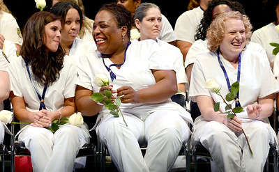 Crystal D'Onofrio, Katherine Burl, and Heather Brady are all smiles after receiving their nursing pins on Aug. 1. KRISTIN BAUER   CHRONICLE