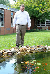 Michael Basinski, principal at Northwood Middle School, looks at the waterfall gardens in the courtyard. STEVE MANHEIM/CHRONICLE