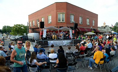 Amherst residents gathered downtown to listen to music, have fun, and try a variety of local food selections during the dancing downtown event on Aug. 2.  KRISTIN BAUER | CHRONICLE