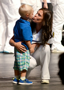 Crystal D'Onofrio kisses her son Logan Hill, 2, of North Ridgeville, after he gave her her nursing pin on Aug. 1.  KRISTIN BAUER | CHRONICLE