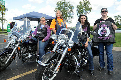 Bonnie Napier, left, Christine Jones, Lisa Thuning and Teresa Cole, organizers of the Celtic Sisters Women's Motorcycle Club, are seen at Quaker Steak and Lube in Sheffield Village on Aug. 14. STEVE MANHEIM/CHRONICLE