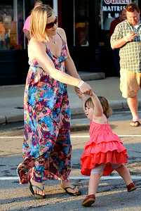 Jina Saunders and her daughter Ellie, 2, both of Bay Village, dance on Park Avenue in Amherst during the annual dancing downtown event on Aug. 2.   KRISTIN BAUER   CHRONICLE