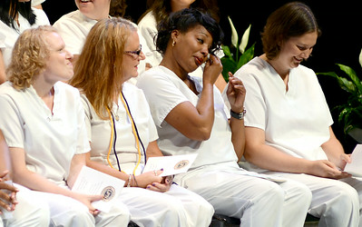 Ishikia Bennett wipes a tear during the nurses pinning ceremony on Aug. 1. KRISTIN BAUER   CHRONICLE