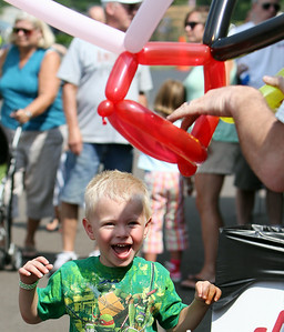 Jett Sikora, 4, of Elyria, smiles with excitement as he waits for a balloon artist to finish making him at hat during the final day of the fourth annual Our Lady Queen of Peace Home Days Festival in Grafton Sunday afternoon. ANNA NORRIS/CHRONICLE