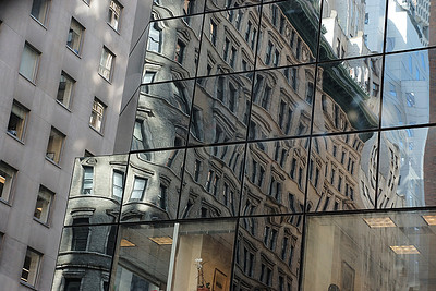Distorted reflections in a building in New York City