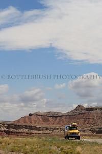 Yellow truck pulling Airstream trailer in Utah.