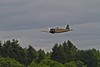 "A Mitsubishi A6M3-22 Reisen (""Zero"")  just above the treetops.<br /> Photo © Carl Clark"