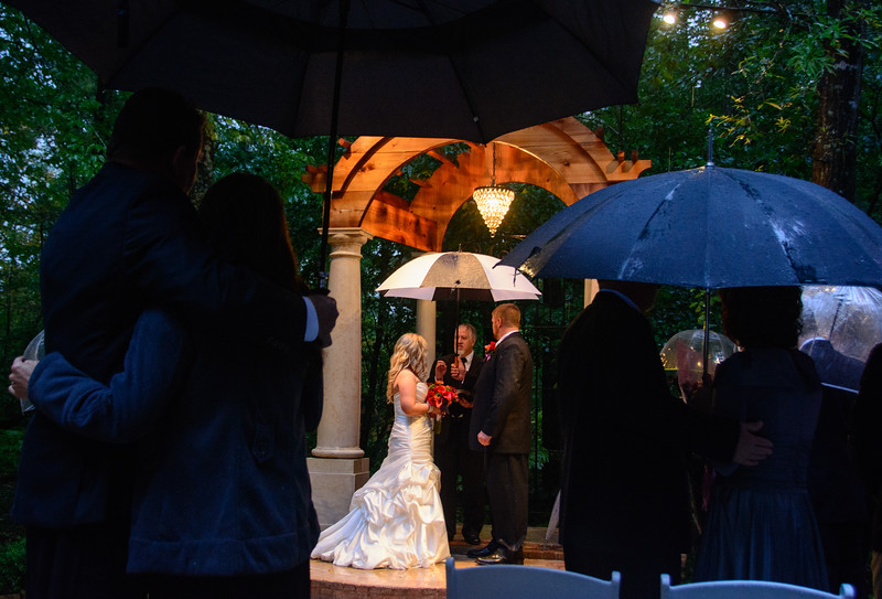With everyone under umbrellas and the rain coming down, a decidedly different and special wedding