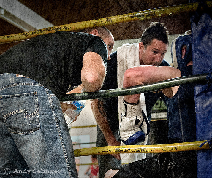 Boxing match, time out in the blue corner.