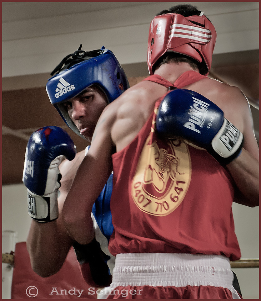 Two young boxers in the ring.