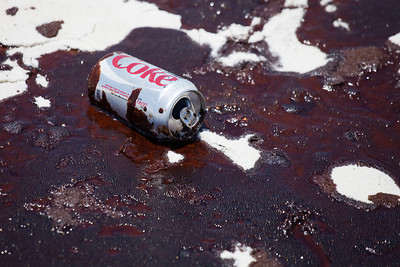 Coke can in te oily sand. Taken 6-23-2010 on Pensacola Beach. The day the oil hit hard. Black Wednesday.